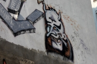 Der Teufel raucht ein Zigarettchen, Graffiti an einer Hauswand in Berlin-Friedrichshain