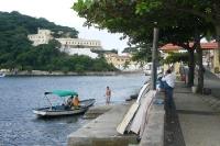 Angler mit Boot in Urca in Rio de Janeiro