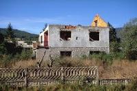 traurige Kriegsspuren in Kroatien - zerstörtes Wohnhaus