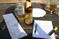 Reisenotizen und Landkarte bei einer Tour durch Österreich